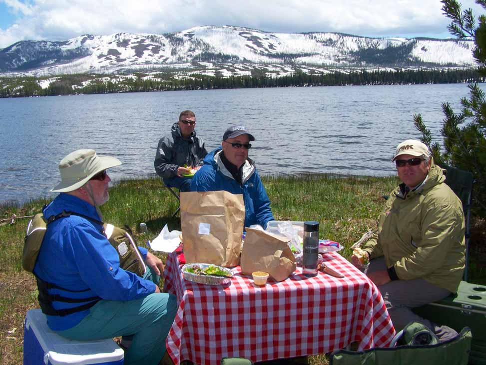 Yellowstone Lewis Lake picnic - fly fishers having brunch